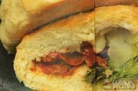 Calzone de rúcula e tomate seco
