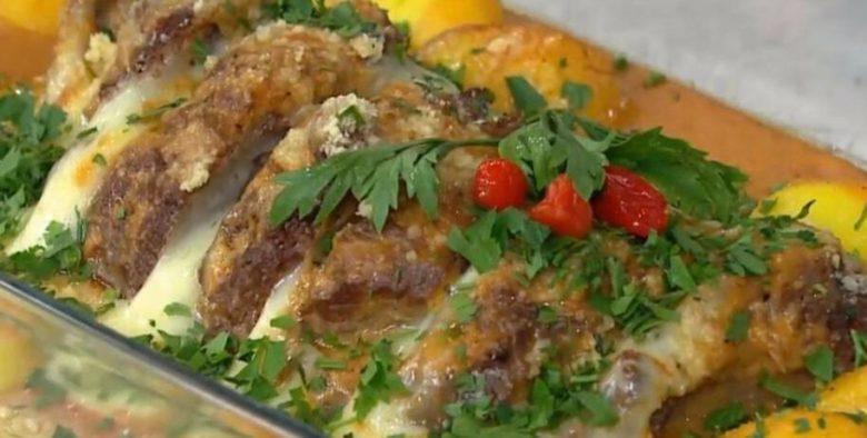 Carne ao molho de laranja e parmesão gratinado
